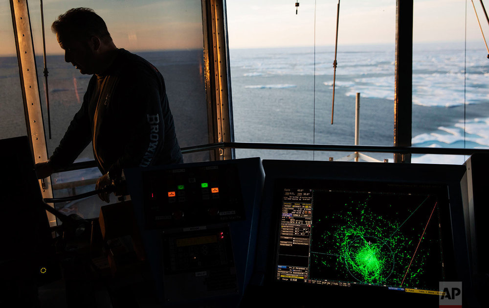A radar screen shows sea ice ahead of the Finnish icebreaker MSV Nordica during transit through the Northwest Passage in the Canadian Arctic Archipelago as first officer Jukka Vuosalmi stands on the bridge, Friday, July 21, 2017. Once the ship entered the fabled Northwest Passage between the Atlantic and the Pacific, there would be nowhere to stop for supplies, no port to shelter in and no help for hundreds of miles if things went wrong. A change in the weather might cause the mercury to drop suddenly or push the polar pack into the Canadian Archipelago, creating a sea of rock-hard ice. (AP Photo/David Goldman)