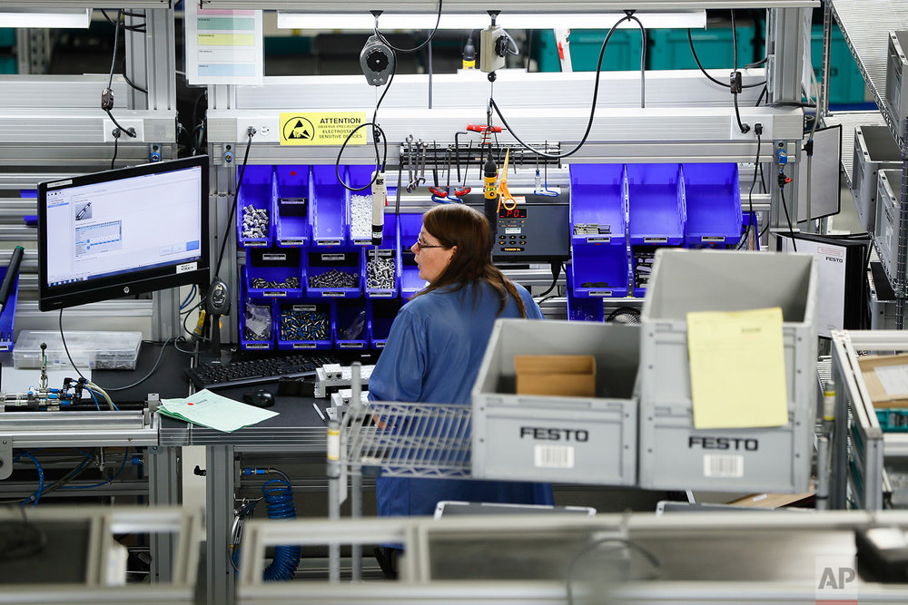 "In this Wednesday, May 17, 2017 photo, an employee stands at her workstation at the Festo distribution center in Mason, Ohio. As manufacturing automations grow, specialized technical jobs are forecasted to increase. The need to fill those jobs ""will happen very quickly,"" said Yannick Schilly, vice president for North American business for Germany-based Festo, a global industrial automation company. ""Those who are positioning themselves the best to cope with technical evolution will be the winners of tomorrow."" (AP Photo/John Minchillo)"