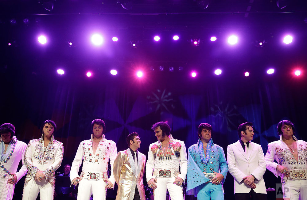 In this July 16, 2017, photo, Elvis tribute artists line up before the winners are announced during the Images of the King: Las Vegas tribute artist contest in Las Vegas. The company holds Elvis Presley festivals and contests in several cities around the country every year. (AP Photo/John Locher)