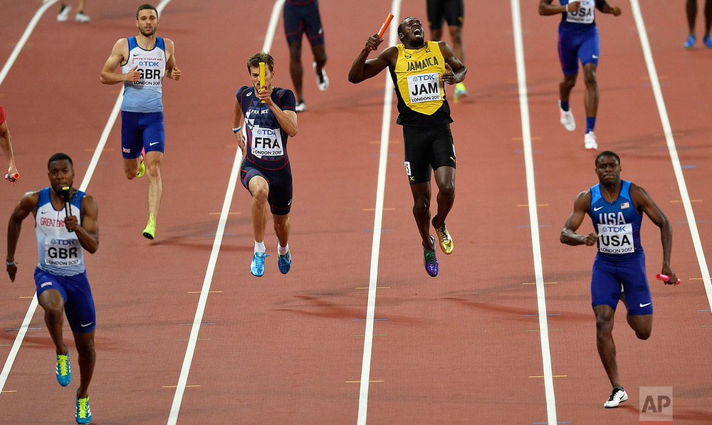 Jamaica's Usain Bolt reacts as he pulls up injured in the Men's 4x100 meters relay final at the World Athletics Championships in London Saturday, Aug. 12, 2017. (AP Photo/Martin Meissner)