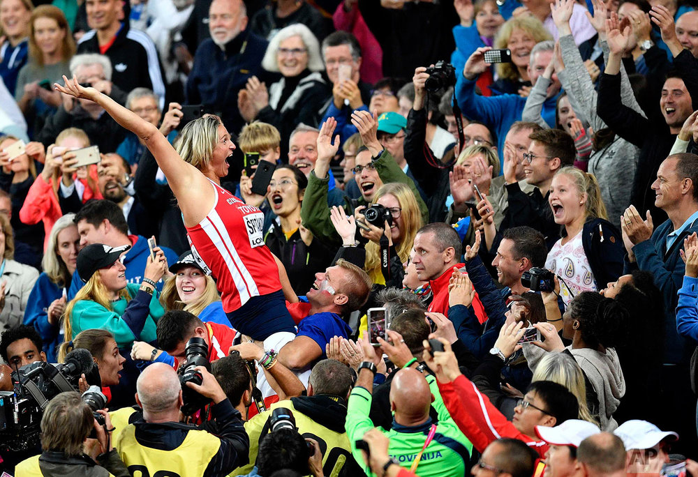 Czech Republic's Barbora Spotakova celebrates after winning the Woman's javelin at the World Athletics Championships in London Tuesday, Aug. 8, 2017. (AP Photo/Martin Meissner)