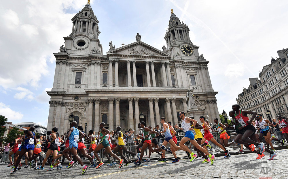 Kenya's Geoffrey Kipkorir Kirui, right, runs past St. Paul's Cathedral in the Men's Marathon during the World Athletics Championships Sunday, Aug. 6, 2017. (AP Photo/Martin Meissner)