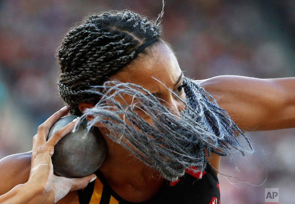 Belgium's Nafissatou Thiam makes an attempt in the shot put of the heptathlon during the World Athletics Championships in London Saturday, Aug. 5, 2017. (AP Photo/Matthias Schrader)