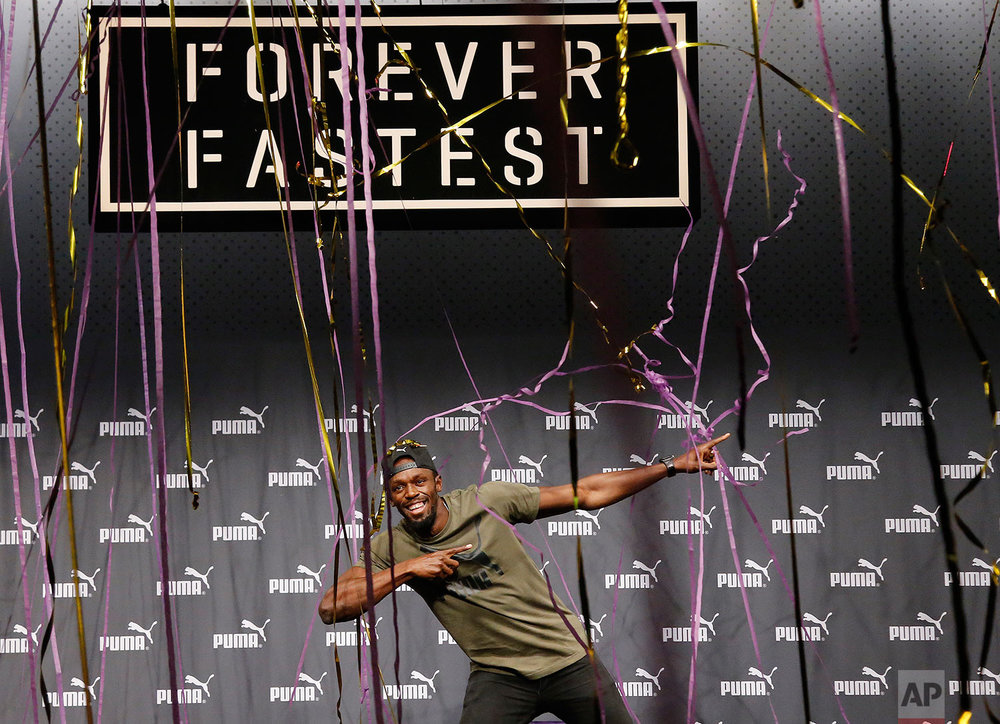 Jamaican athlete Usain Bolt celebrates after a press conference ahead of the World Athletics championships in London, Tuesday, Aug. 1, 2017. Sprint legend Bolt, a multiple Olympic and World Championship gold medallist, is set to retire after the World Championships in London, which begin on Friday Aug. 4. (AP Photo/Frank Augstein)