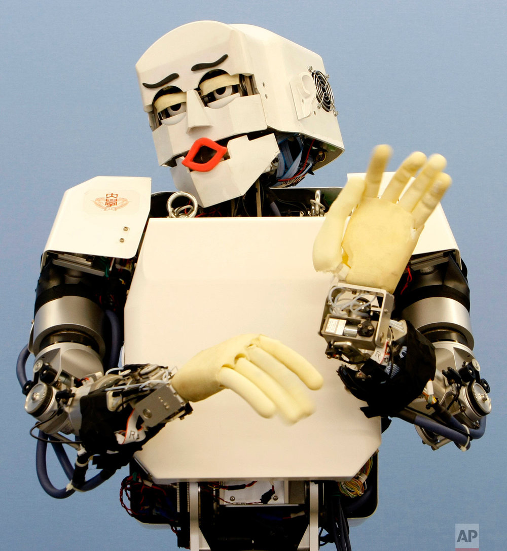 "In this Tuesday, June 23, 2009 photo, humanoid robot KOBIAN shows an emotional display of ""disgust"" during a demonstration at Waseda University in Tokyo. KOBIAN, that can express seven programmed emotions by using its entire body including facial expressions, has been developed by researchers at Waseda's Graduate School of Advanced Science and Engineering, led by Prof. Atsuo Takanashi, and robot manufacturer tmsuk, based in Kita Kyushu, southern Japan. (AP Photo/Shizuo Kambayashi)"