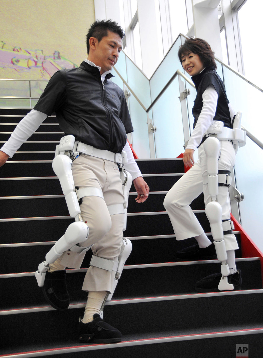 In this Tuesday, Oct. 7, 2008 photo, robotic suits named HAL (Hybrid Assistive Limb) are demonstrated during a news conference at the headquarters of Cyberdyne, a new company in Tsukuba, outside Tokyo. HAL, which reads brain signals and helps people with mobility problems, will be available to rent in Japan for US$2,200 for both legs and $1,500 for a one leg a month and may have far-reaching benefits for the disabled and elderly. (AP Photo/Katsumi Kasahara)