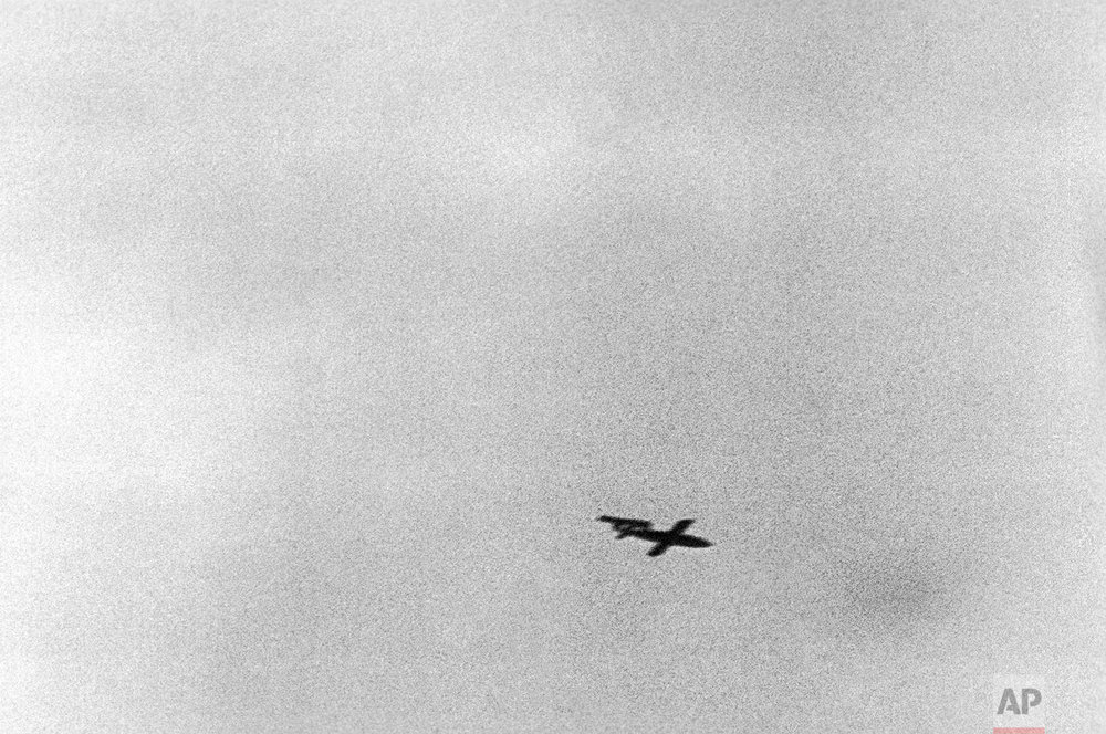 This undated photo shows a German V1 robot bomb flying towards London. Of the 8,000 launched, 2,300 robots got through the gun, fighter plane and balloon defenses, and badly damaged more than a million homes, killing over 5,000 British civilians. (AP Photo)