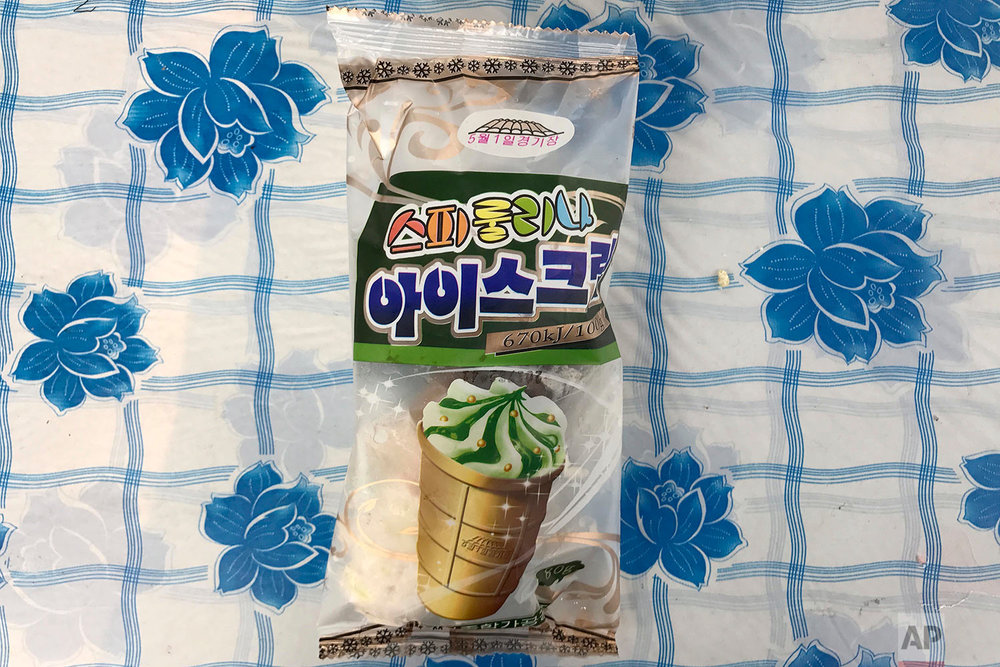 In this June 17, 2017, photo, a spirulina (blue-green algae superfood) flavored May Day Stadium ice-cream cone is seen in its packaging in Pyongyang, North Korea. (AP Photo/Wong Maye-E)