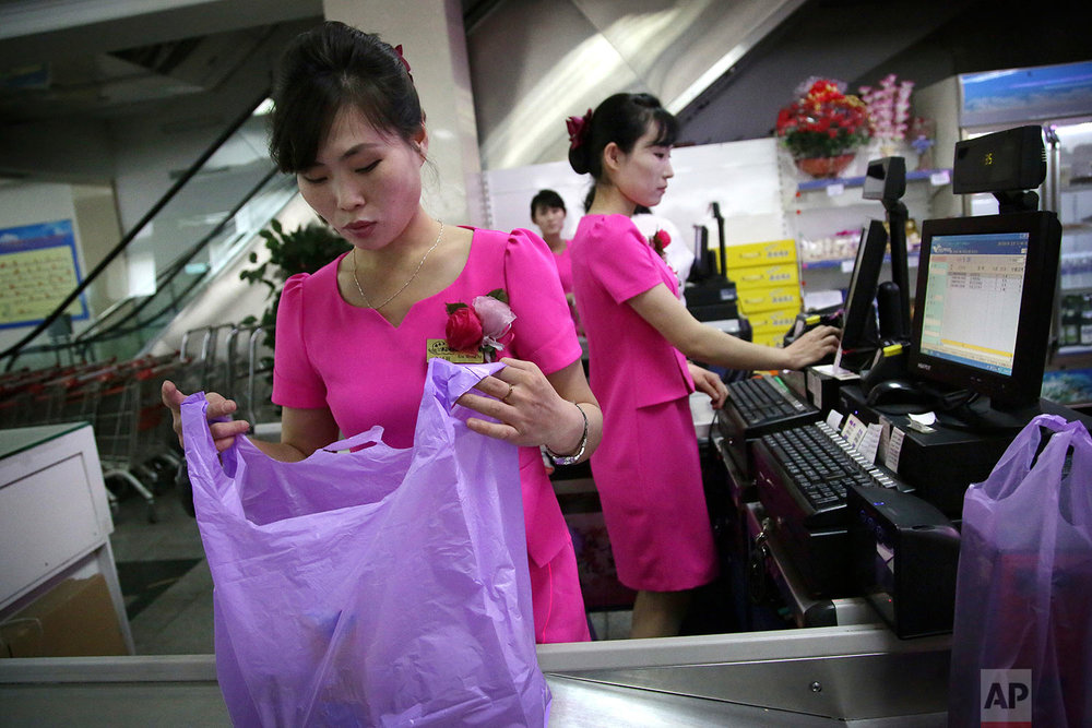 In this Monday, June 19, 2017, photo, cashiers work at the Potonggang department store in Pyongyang, North Korea. (AP Photo/Wong Maye-E)