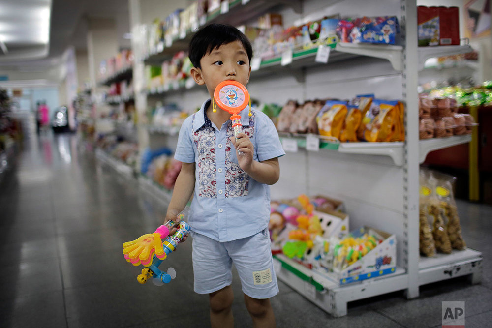 In this Monday, June 19, 2017, photo, a boy stands in the aisle at the Potonggang department store in Pyongyang, North Korea. (AP Photo/Wong Maye-E)