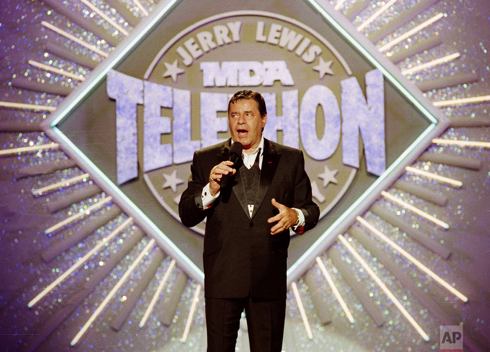 In this Sept. 2, 1990 photo, entertainer Jerry Lewis makes his opening remarks at the 25th Anniversary of the Jerry Lewis MDA Labor Day Telethon fundraiser in Los Angeles. (AP Photo/Julie Markes)