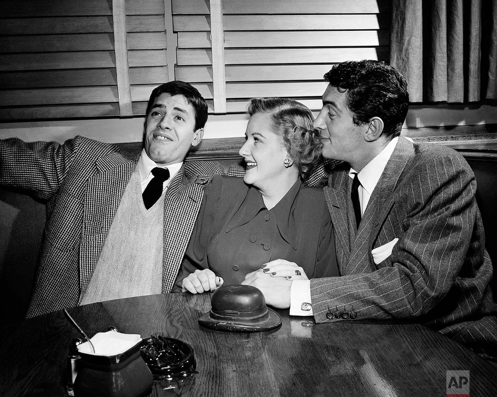 "Jerry Lewis (left) whips through his portion of the famous Lewis-Martin comic routine, while Margaret  Whiting and Dean Martin look on at the Hollywood Brown Derby on Jan. 21, 1949 in Los Angeles.    Martin and Lewis soon will make their film debut in ""My Friend Irma.""    (AP Photo)"