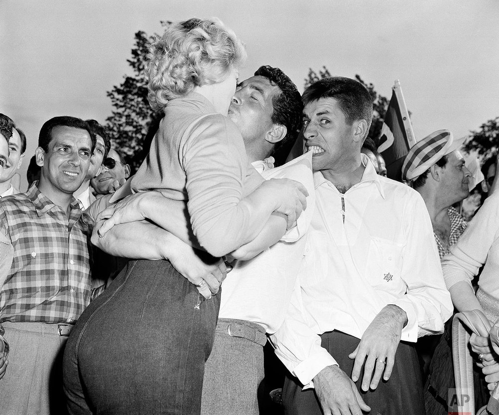 Dean Martin, center, and Jerry Lewis, right, are shown with actress Denise Darcel  the on a golf course on May 25, 1953 at the Vernon Hills Country Club in Eastchester, N.Y. (AP Photo)
