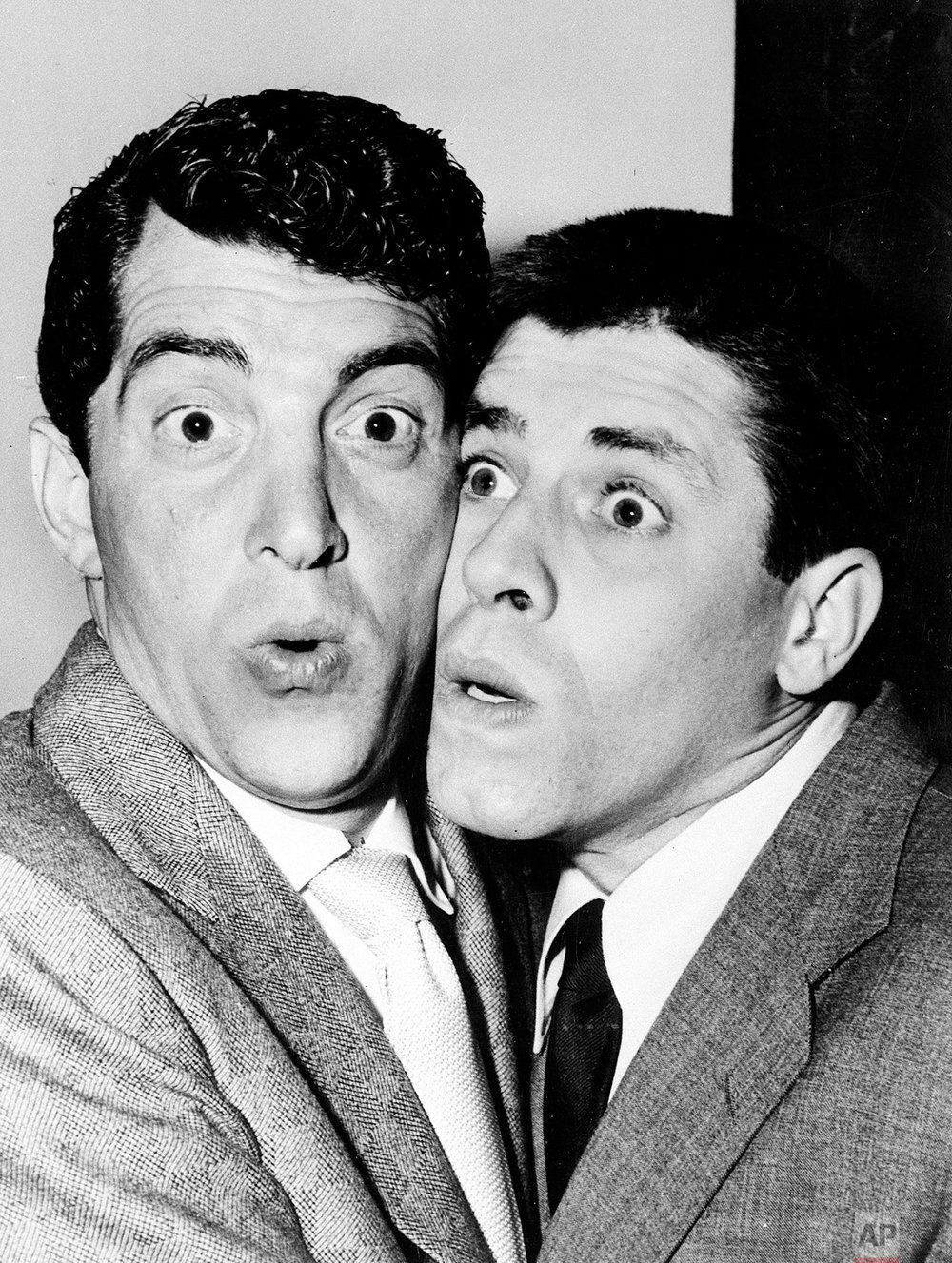 American entertainers Dean Martin, left, and Jerry Lewis pretend to be overwhelmed by the crowd in London, England, June 9, 1953.  The comedy duo will appear at the Glasgow Empire and at the London Palladium.  (AP Photo)