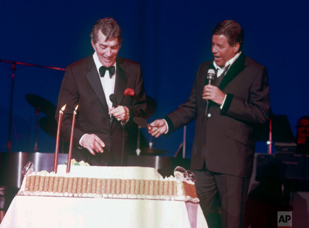 Dean Martin, left, laughs after former partner Jerry Lewis, right, presented the famed entertainer with a giant cake in honor of his 72nd birthday at Bally's in Las Vegas June 8, 1989. (AP Photo)