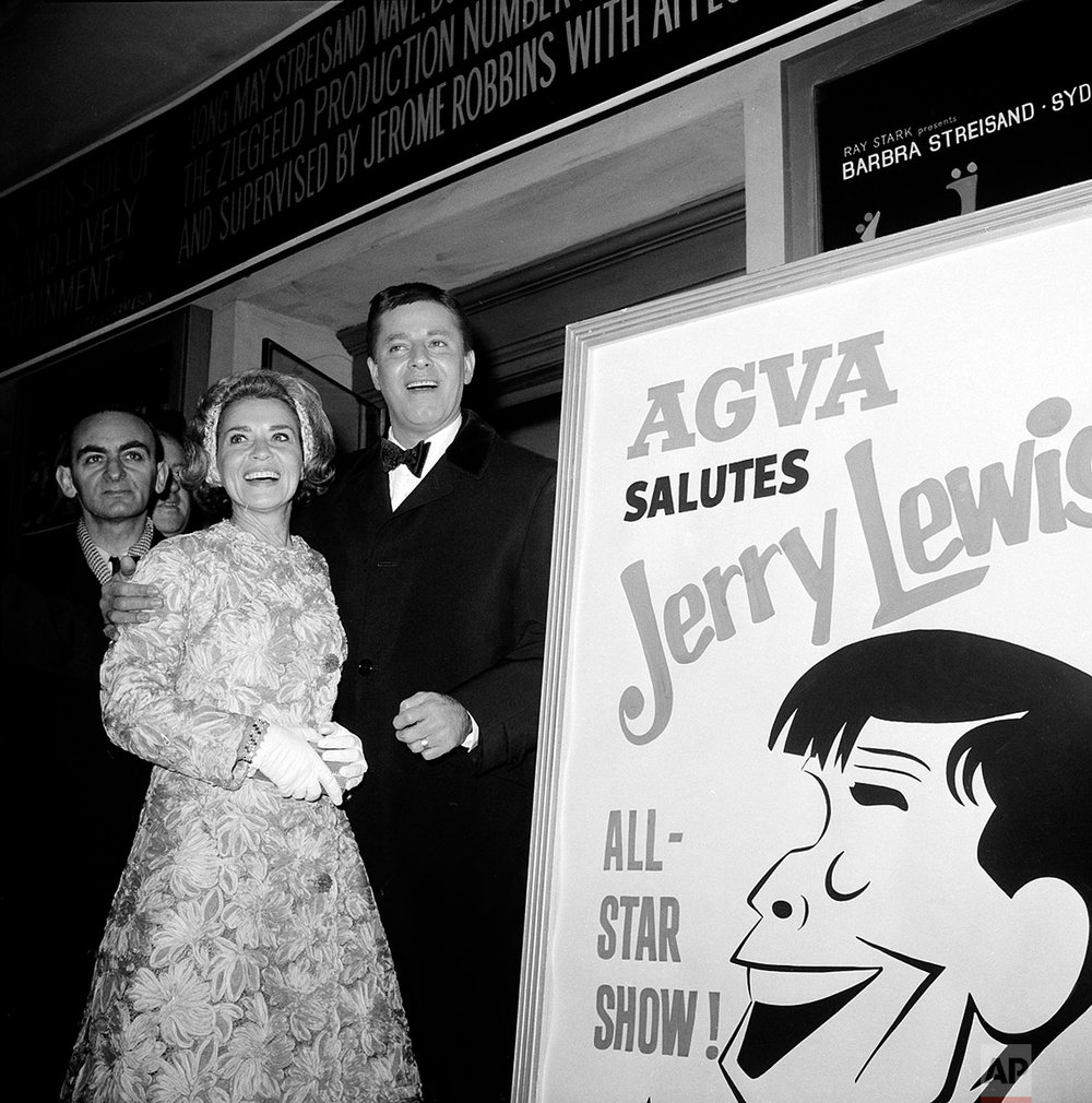 Actor-comedian Jerry Lewis and his wife, singer Patti, arrive at the Winter Garden for a tribute to Lewis by the American Guild of Variety Artists (AGVA) in New York City, Dec. 6, 1964.  (AP Photo)