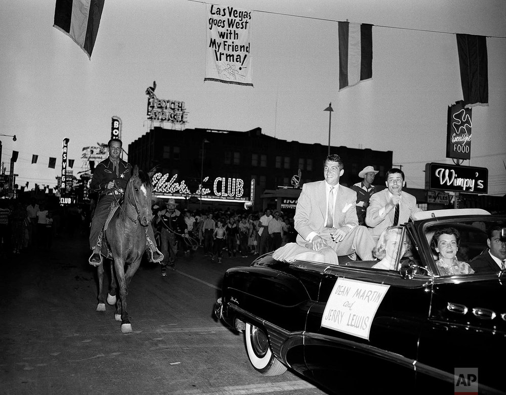 Dean Martin and Jerry Lewis ride down Main Street of Las Vegas, Nev. on April 5, 1953, enroute to theatre for premiere of latest film.  (AP Photo/Frank Filan)