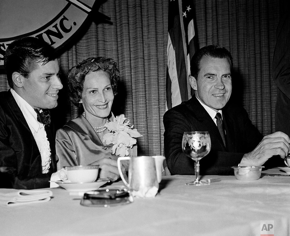 Comedian Jerry Lewis, left, Vice President Richard Nixon, right, and Pat Nixon shown as they sat with at the speakers table at the California Newspaper Publishers World Newspaper Forum, Oct. 15, 1960, Beverly Hills, Calif.  (AP Photo)