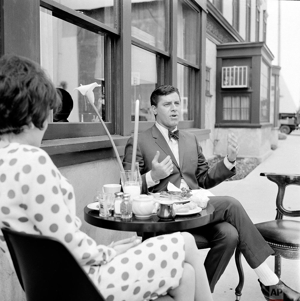 "Actor-comedian Jerry Lewis is shown during a break in filming ""Who's Minding the Store"" on a movie studio lot in Hollywood, Ca., Sept. 27, 1963.  At left is his assistant Carol Saracino.    (AP Photo)"