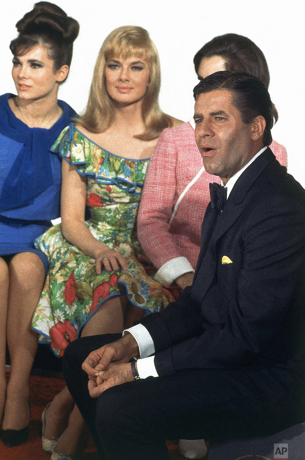 "Actress Leslie Parrish with actress Gila Golan, actor Jerry Lewis re. filming of movie ""Three on a Couch,"" in Hollywood, Calif. on Jan. 6, 1966. (AP Photo)"