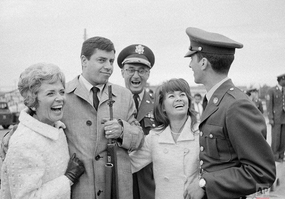 Comedian Jerry Lewis and his wife, Patti, left, with Gen. Monk Meyer, Sara Jane Suzara of Manila, and Lewis' son, Gary, pose for photographers at Fort Ord, Calif., on Feb. 24, 1967. (AP Photo)
