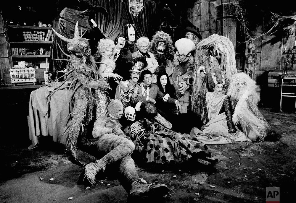 Just about every horror monster ever invented for the movie industry was assembled by Sonny Bono and Cher and their guest star, Jerry Lewis, center, for the taping of their television show to be aired by CBS on Halloween, Friday, Oct. 4, 1973, Los Angeles, Calif. In the group, among others, are Frankensteins monster, Dracula, the Mad Scientist, Wolfman, Sea Monster, Cyclops, Bat Girl, and Bride of Frankenstein. (AP Photo/David F. Smith)