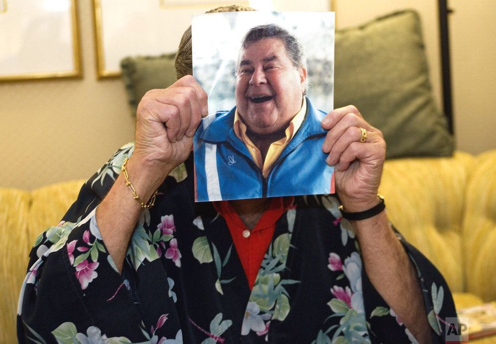 Comedian Jerry Lewis, holding up a photo of himself bloated from drugs he was taking to overcome chronic pain, is interviewed Thursday, Nov. 3, 2005, at the Beverly Hills hotel in Beverly Hills, Calif. (AP Photo/Damian Dovarganes)