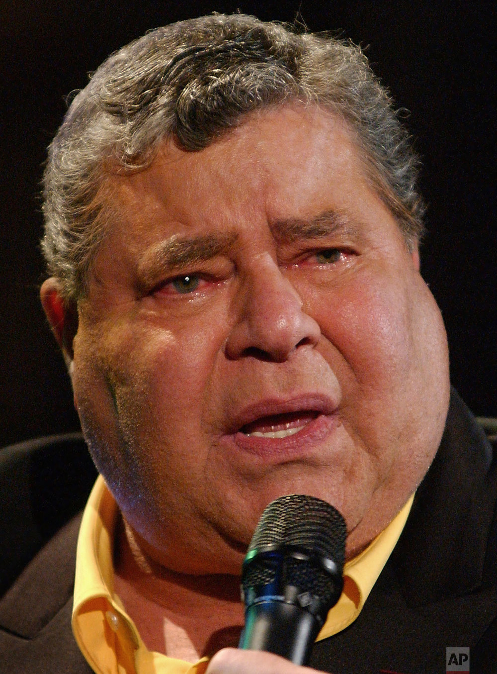 Muscular Dystrophy Association National Chairman Jerry Lewis speaks at the end of his 36th annual Labor Day weekend telethon in Los Angeles, Monday, Sept. 2, 2002. Lewis is swollen from the effects of steroid-based medication for a lung condition. The show raised a record $56.8 million in donations. (AP Photo/Lucy Nicholson)