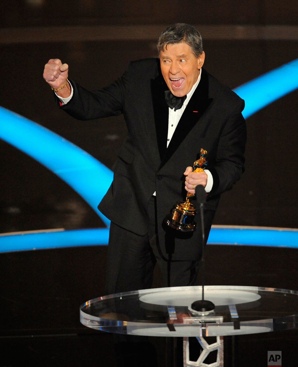 In this Sunday, Feb. 22, 2009 photo, Jerry Lewis accepts the Jean Hersholt Humanitarian Award by the Board of Governors of the Academy of Motion Picture Arts and Sciences during the Oscars telecast during the 81st Academy Awards, in the Hollywood section of Los Angeles. (AP Photo/Mark J. Terrill)