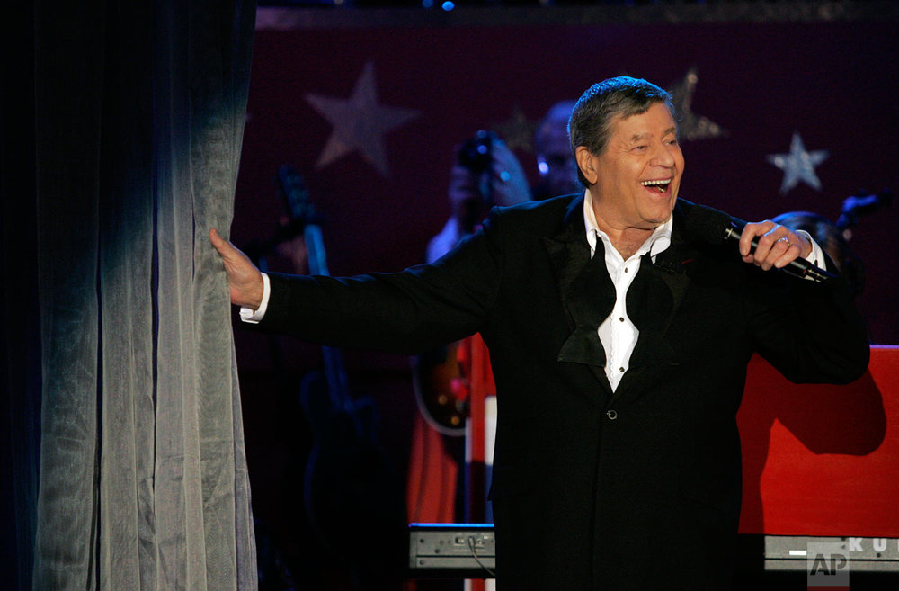 Jerry Lewis performs during the Jerry Lewis Labor Day Telethon in Beverly Hills, Calif., Monday, Sept. 5, 2005. The telethon raised $54.9 million for the muscular dystrophy research and services. (AP Photo/Jae C. Hong)