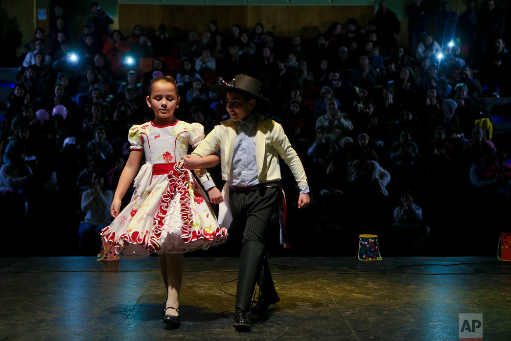 """In this Aug. 19, 2017 photo, transgender children, Selenna, 8, and Kevin, 12, perform in traditional Chilean outfits at an event celebrating Transgender Children Day in Santiago, Chile. An appellate court in Santiago accepted in June a transgender adult's right to change the registry. It said """"every person has the right to the free development of their personality in accordance with their own determination of gender.""""  (AP Photo/Esteban Felix)"""