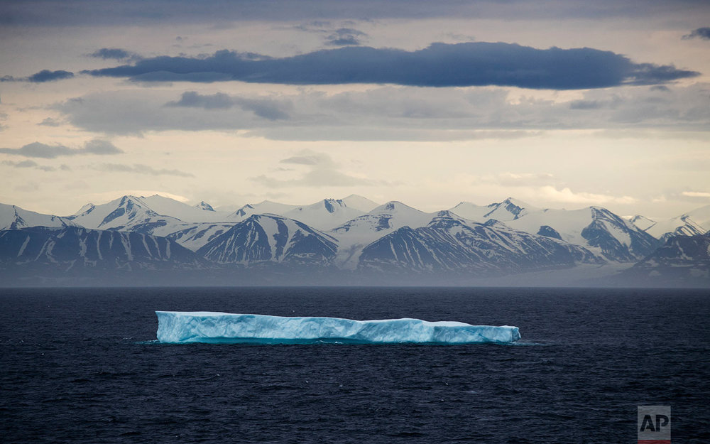 An iceberg floats past Bylot Island in the Canadian Arctic Archipelago, Monday, July 24, 2017.  (AP Photo/David Goldman)