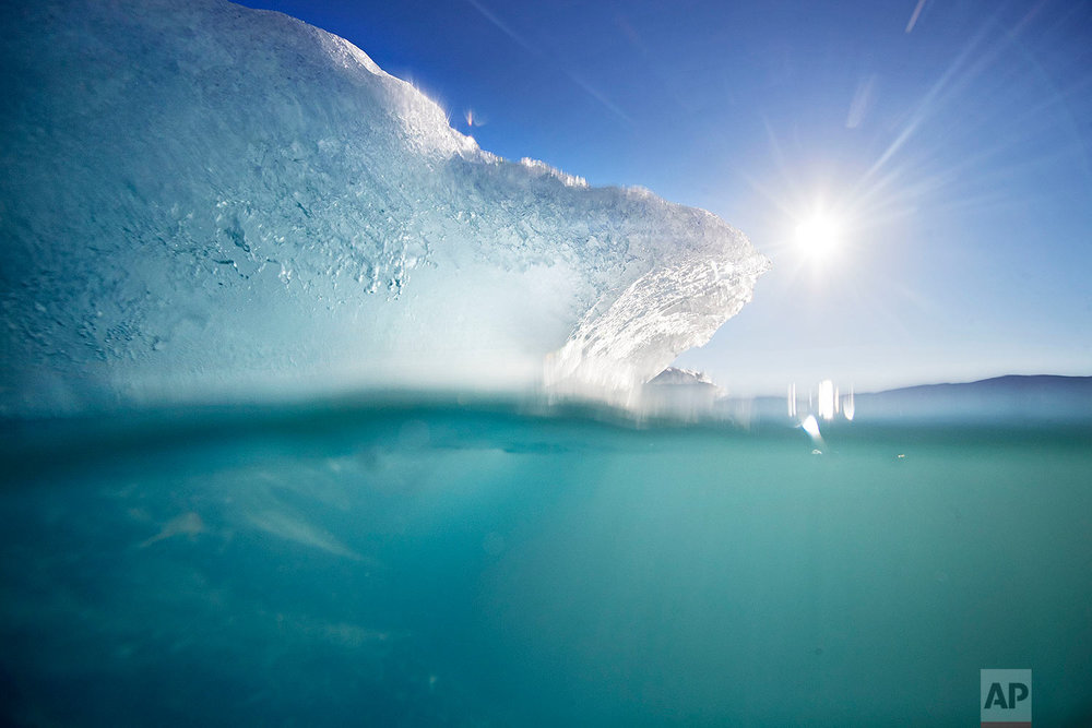 An icebergs floats in the Nuup Kangerlua Fjord near Nuuk in southwestern Greenland, Tuesday, Aug. 1, 2017. (AP Photo/David Goldman)