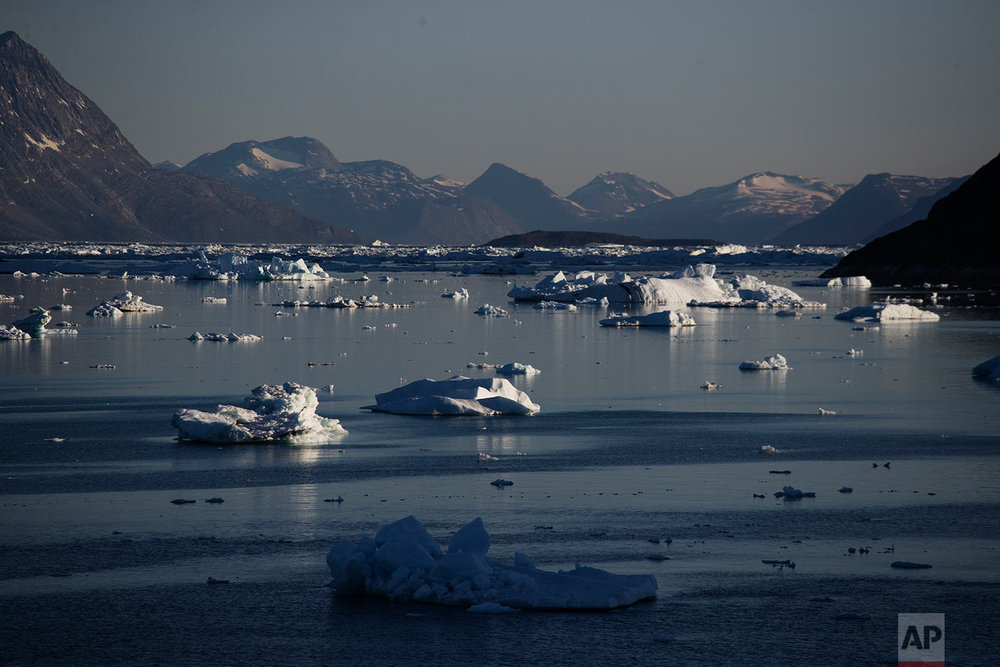 Icebergs float in the Nuup Kangerlua Fjord after breaking off a glacier on Greenland's ice sheet in southwestern Greenland, Tuesday, Aug. 1, 2017. (AP Photo/David Goldman)