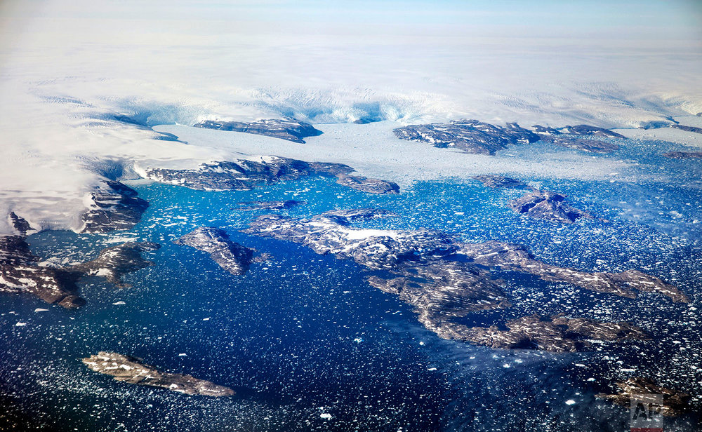 Icebergs float in a fjord after calving off from glaciers on the Greenland ice sheet in southeastern Greenland, Thursday, Aug. 3, 2017. (AP Photo/David Goldman)