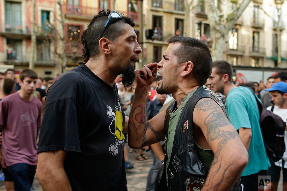 A counter protester and a far-right protester argue during a gathering after a van attack in Barcelona, Spain, Friday Aug. 18, 2017. (AP Photo/Manu Fernandez)