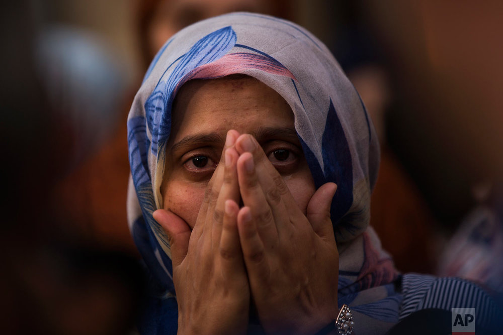 In this Sunday, Aug. 20, 2017 photo, a woman weeps during a gathering of members of the local Muslim community along with relatives of young men believed responsible for the attacks in Barcelona and Cambrils to denounce terrorism and show their grief in Ripoll, north of Barcelona, Spain. (AP Photo/Francisco Seco)