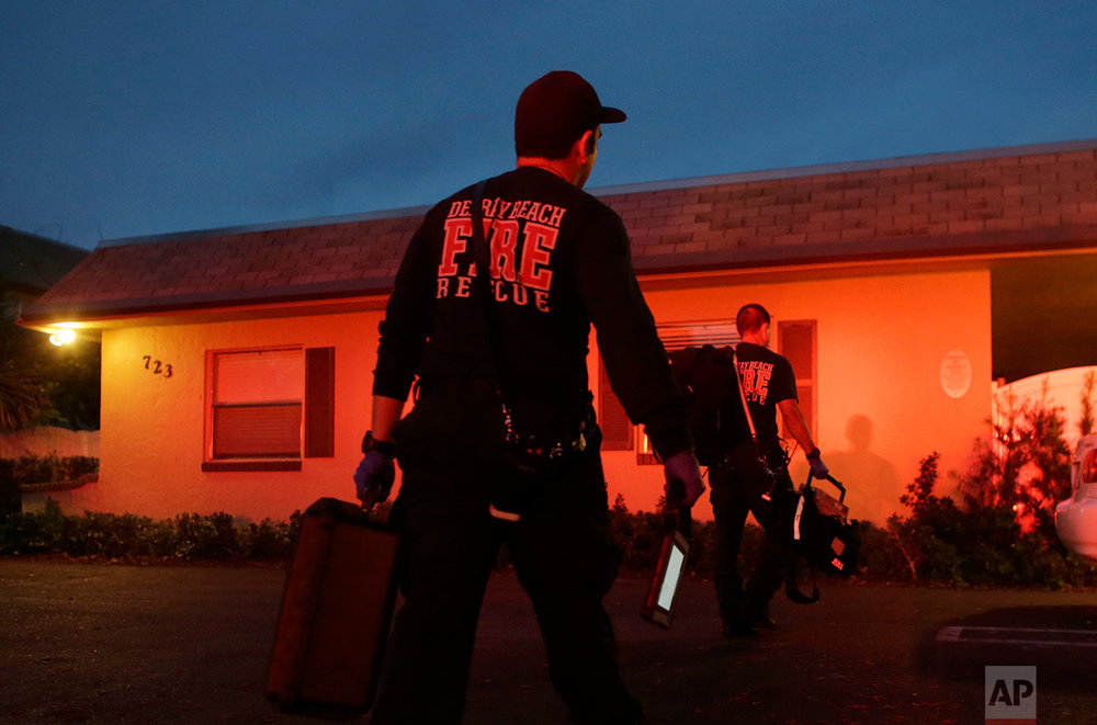 In this Friday, July 21, 2017 photo, officials with Delray Beach Fire Rescue, respond to a call at a drug treatment center in Delray Beach, Fla. (AP Photo/Lynne Sladky)