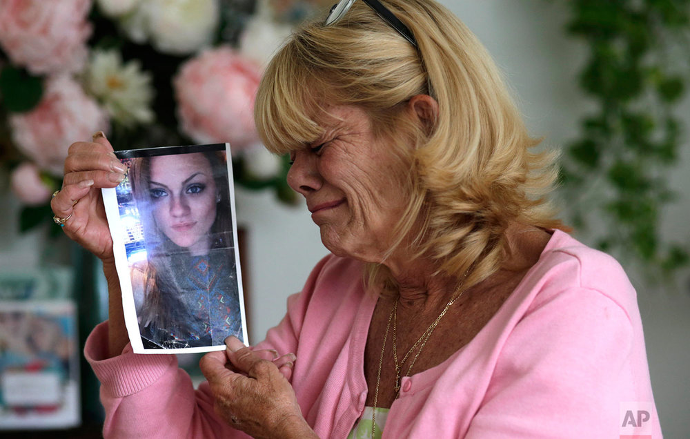 In this Thursday, July 13, 2017 photo, Michelle Holley holds a photograph of her daughter Jaime Holley, 19, who died of a heroin overdose in November 2016, at her home in Fort Lauderdale, Fla. (AP Photo/Lynne Sladky)