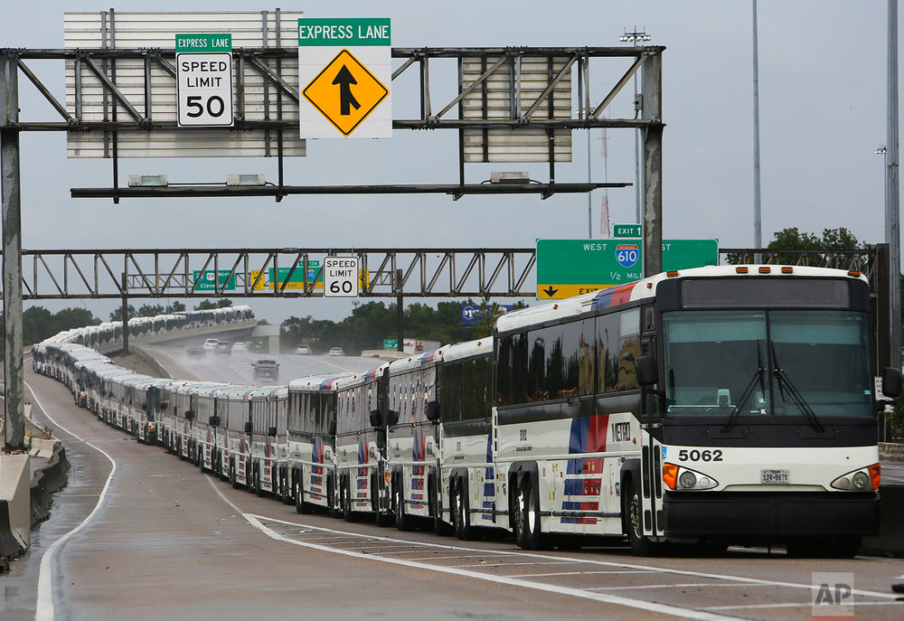As a preventative measure, empty Metro buses are lined up in the center lanes of Interstate 59 near Cavalcade in case their bus shelters flood, Saturday, Aug. 26, 2017, in Houston. (Mark Mulligan/Houston Chronicle via AP)
