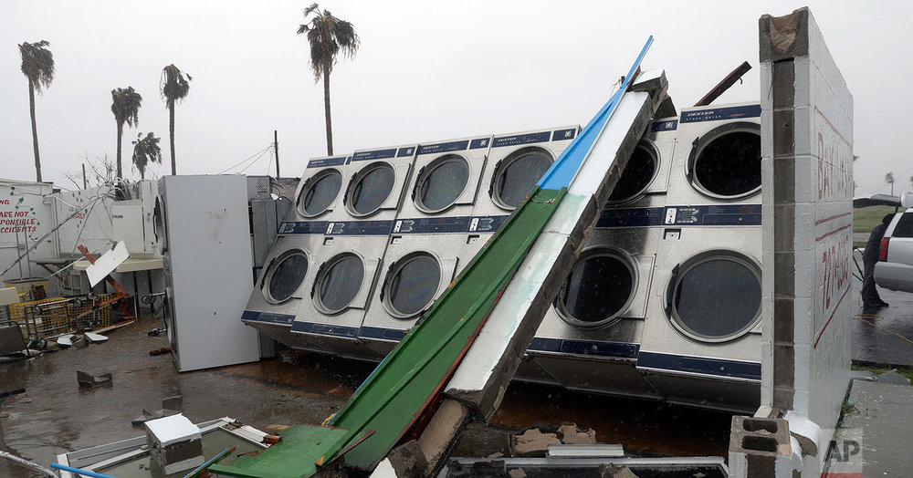 A row of clothes dryers are exposed to the elements after a laundromat lost its roof and portions of walls in the wake of Hurricane Harvey, Saturday, Aug. 26, 2017, in Rockport, Texas. (AP Photo/Eric Gay)