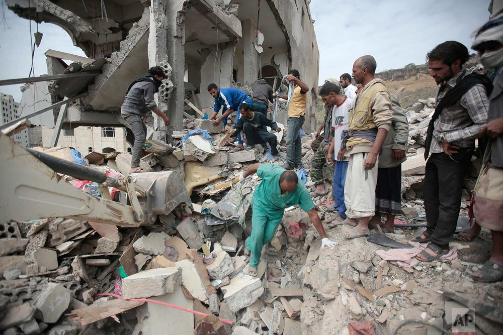 People inspect the rubble of houses destroyed by Saudi-led airstrikes in Sanaa, Yemen, on Friday, Aug. 25, 2017. (AP Photo/Hani Mohammed)