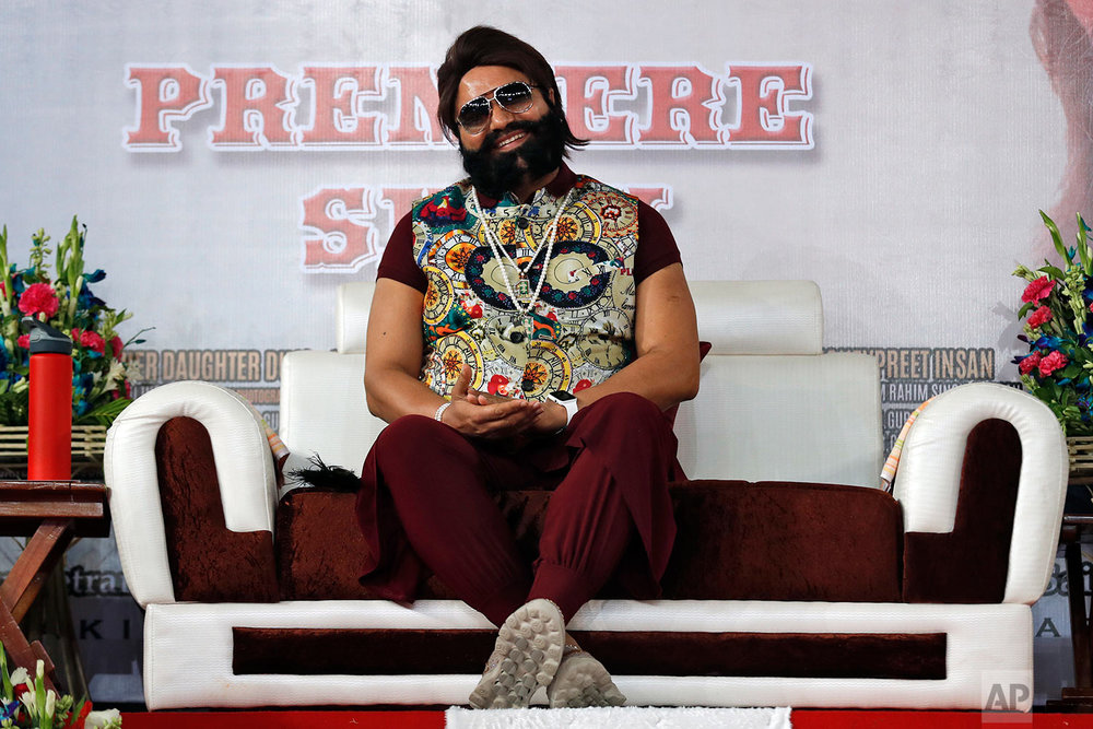 "In this May 17, 2017 photo, an Indian spiritual guru, who calls himself Dr. Saint Gurmeet Singh Ram Rahim Insan, attends the premiere of the movie ""Jattu Engineer"" in New Delhi, India. A judge on Monday, Aug. 28, 2017 sentenced the flamboyant and controversial Indian spiritual guru to prison on charges of raping two female followers. (AP Photo/Tsering Topgyal)"