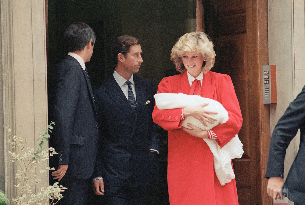 Prince Charles and Princess Diana with newborn son Prince Henry in 1984