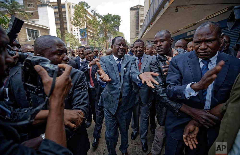 Opposition leader Raila Odinga arrives at the Supreme Court in downtown Nairobi, Kenya Friday, Sept. 1, 2017. On Friday, the Supreme Court nullified President Uhuru Kenyatta's August election win and called for new elections within 60 days, shocking a country that had been braced for further protests by opposition supporters. (AP Photo/Ben Curtis)