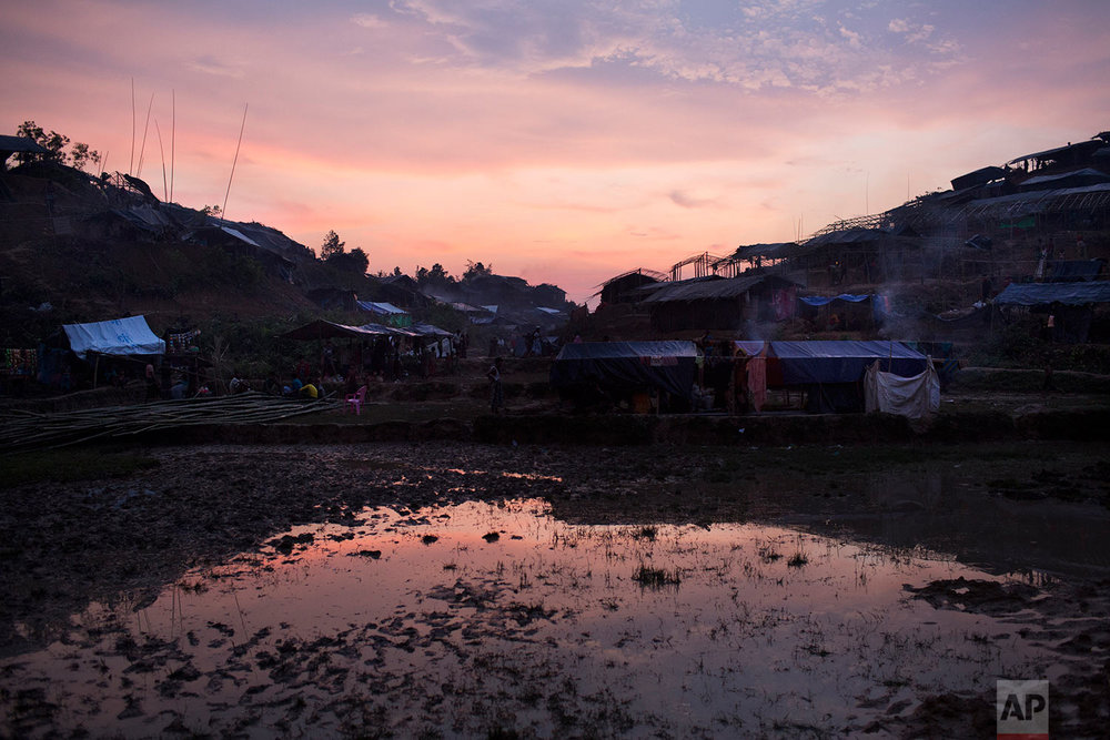 Dusk settles over a new camp inhabited by Rohingya Muslims near Cox's Bazar's Gundum area, Bangladesh, Tuesday, Sept. 5, 2017. Bangladesh, one of the world's poorest countries, was already sheltering some 100,000 Rohingya refugees before another 123,000 flooded in after Aug. 25, according to the U.N. refugee agency's latest estimate on Tuesday. (AP Photo/Bernat Armangue)
