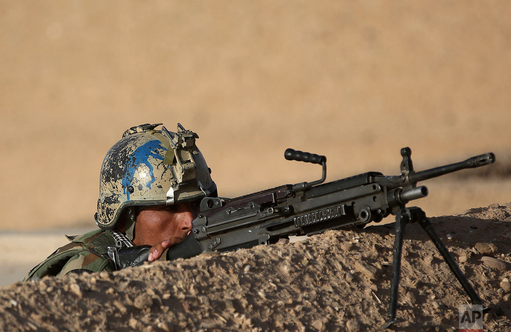 An Afghan army commando exercises during a training session in the Shorab military camp in Helmand province, Afghanistan on Aug. 27, 2017. (AP Photo/Massoud Hossaini)