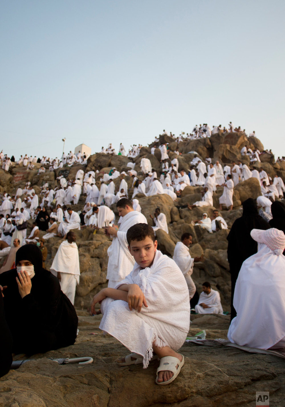 Muslim pilgrims gather to pray on and around the Jabal Al Rahma holy mountain, or the mountain of forgiveness, at Arafat for the annual hajj pilgrimage outside the holy city of Mecca, Saudi Arabia, Thursday, Aug. 31, 2017. (AP Photo/Khalil Hamra)