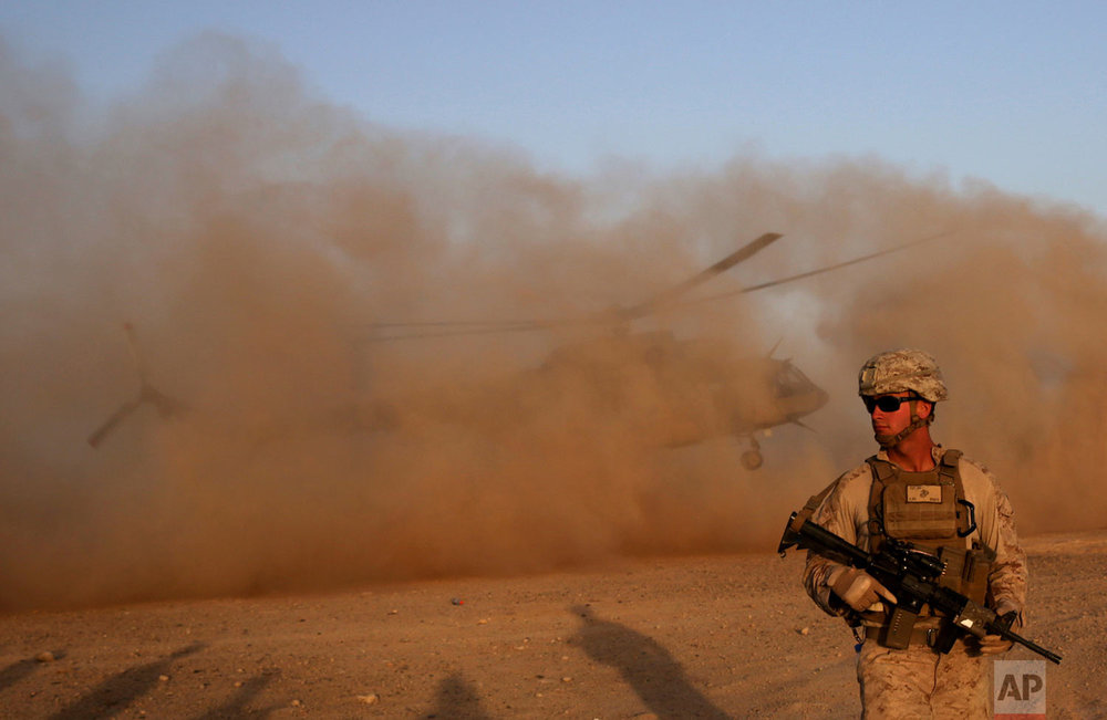 A U.S. Marine takes part during a training session for Afghan army commandos in Shorab military camp in Helmand province, Afghanistan on Aug. 27, 2017. (AP Photo/Massoud Hossaini)