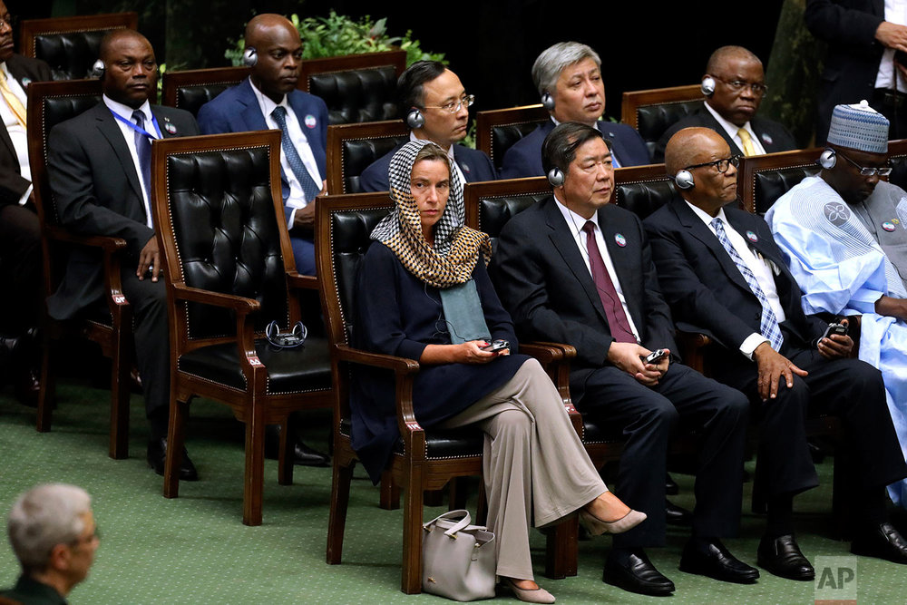 European Union foreign policy chief Federica Mogherini, left, attends the swearing-in ceremony of President Hasan Rouhani for the second term in office, at the parliament in Tehran, Iran, Saturday, Aug. 5, 2017. (AP Photo/Ebrahim Noroozi)